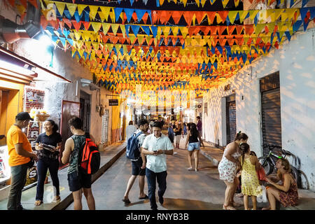 Cartagena Colombia Old Walled City Center centre Getsemani night nightlife Hispanic neighborhood resident residents Calle San Andres colorful flags ba - Stock Image
