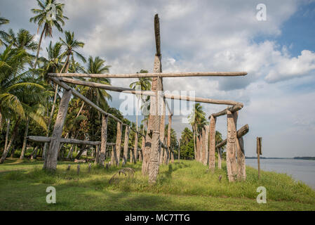 Hand carved poles of a collapsed ancient haus tambaran, Korogo Village, Middle Sepik, Papua New Guinea - Stock Image