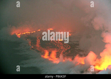 Hawaii. 9th July 2018. An early morning rain causes steam to rise from lava flows from the Kilauea volcano July 9, 2018 in Hawaii. The recent eruption continues destroying homes, forcing evacuations and spewing lava and poison gas on the Big Island of Hawaii. Credit: Planetpix/Alamy Live News - Stock Image