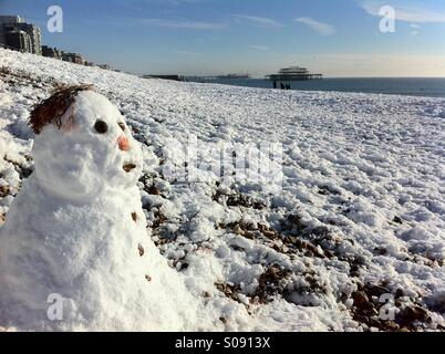 snowman on Brighton beach. England - Stock Image