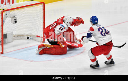 Bratislava, Slovakia. 19th May, 2019. Michal Repik (CZE), right, scores against goaltender Lukas Herzog (AUT) in the match between Austria and Czech Republic within the 2019 IIHF World Championship in Bratislava, Slovakia, on May 19, 2019. Credit: Vit Simanek/CTK Photo/Alamy Live News - Stock Image