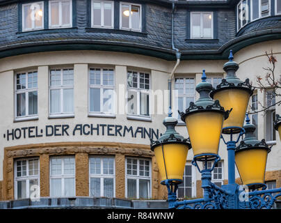 Goslar, Germany, December 11., 2018: Partial view of the famous Hotel Achtermann in the thick stone walls of the medieval fortifications. - Stock Image