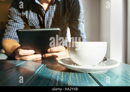 Cafe coffee man tablet computer closeup concept - Stock Image