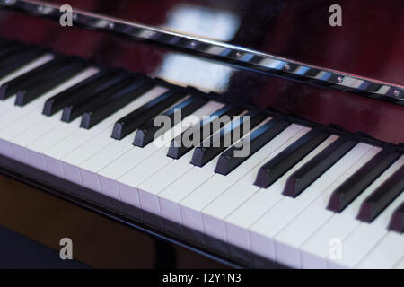 Classical piano keyboard black and withe and brown wood box, musical keys and instrument. Music concept background. Close up, selective  focus - Stock Image