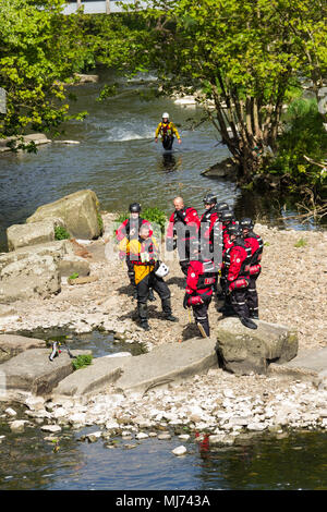 Members of Greater Manchester Fire and Rescue Service undertaking water rescue training in the River Irwell near Burrs Activity Centre, Bury. - Stock Image