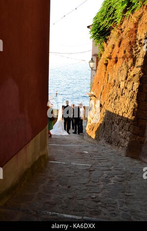 Newly wedded couple faces cameras at Marina Grande, Sorrento,Italy. - Stock Image