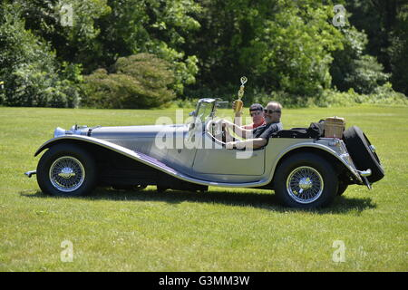 Westbury, New York, USA. June 12, 2016.  MARK OFFENBERG, of Valley Stream, drives his silver 1973 Intermeccanica - Stock Image