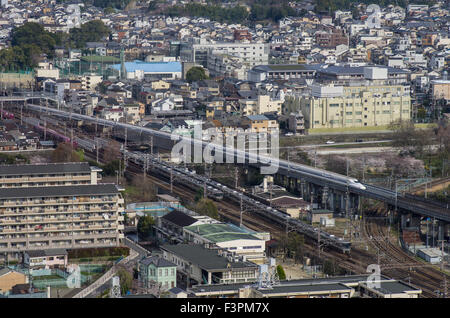 View from Kyoto Tower of the Shinkansen and local trains approaching and leaving Kyoto Station, Japan - Stock Image