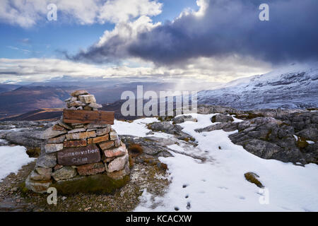 A conservation Cairn on Beinn Eighe with the summit of Creag Dhubh in the distance. Scottish Highlands, Scotland, - Stock Image