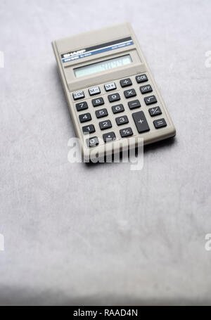 Still life of an old Sharp calculator isolated on a neutral background - Stock Image