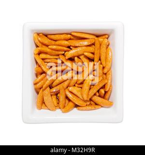 Kaki no tane - Japanese rice crisp in a square bowl isolated on white background - Stock Image
