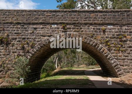 19th-century bluestone bridge over the Barwon at Winchelsea, southwestern Victoria - Stock Image