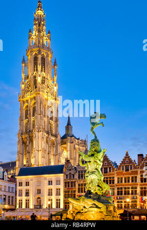 The Brabo fountain in the Grote Markt  ('Great Market Square') with the belfry of the Cathedral of Our Lady  in the background of Antwerp, Belgium - Stock Image
