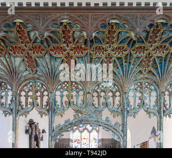 Elaborately decorated wooden rood screen in church of Saint Andrew, Bramfield, Suffolk, England, UK - Stock Image