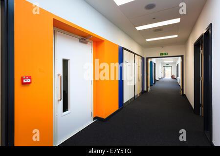 Lift door and corridor at Teddington Sixth Form College. - Stock Image