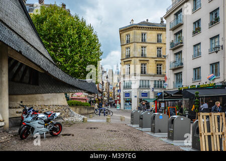 The Rue du Gros Horloge, the main street through old Town Rouen France with the Gros Horloge or Astronomical Clock - Stock Image