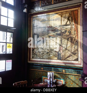 Ceramic tiled panel in City of London public house depicting workers on river front - Stock Image