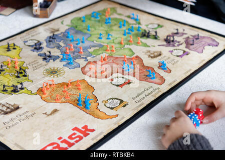 People playing the classic strategy baord game Risk - Stock Image