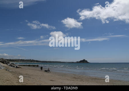 Longrock, Cornwall, UK. 14th June 2019. UK Weather. Early morning clouds lifted to give a warm and sunny lunchtime on the beach at Longrock near Marazion. Credit Simon Maycock / Alamy Live News. - Stock Image