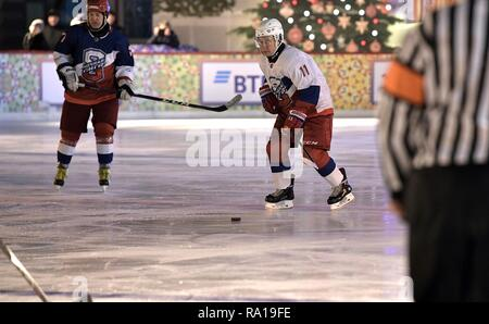 Moscow, Russia. 29th December 2018. Russian President Vladimir Putin #11, right, during ice hockey action at the Night Hockey League match in the rink at the GUM Department store in Red Square December 29, 2018 in Moscow, Russia. Credit: Planetpix/Alamy Live News - Stock Image