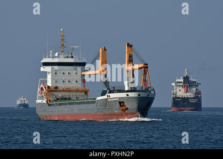 3 general cargo vessels navigating the Kiel fjord: John-Paul K, Trito Navigator, Souselas - Stock Image