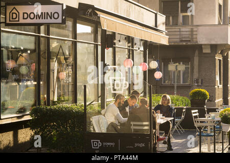 People having cofee at the Domino cafe in Belgrade, Serbia. - Stock Image