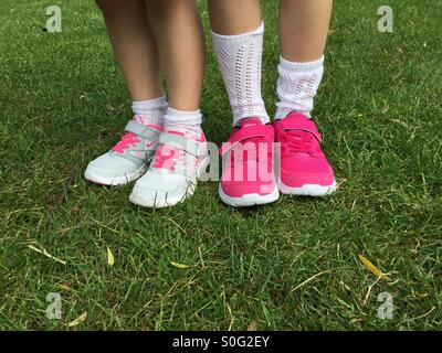 Children's/girls feet, wearing new trainers. Nike shoes - Stock Image