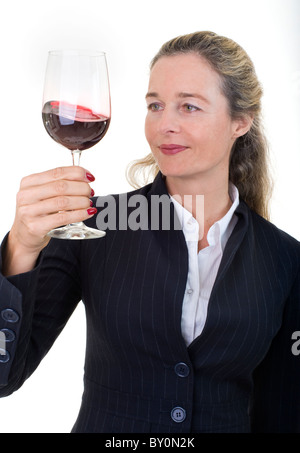 Smiling European business women in her 40's with wine glass isolated on white - Stock Image