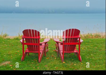 Muskoka chairs and fog St. Joseph's Island Ontario Canada - Stock Image