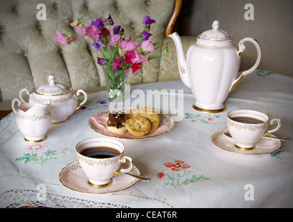 Vintage coffee set. Table set for coffee with old style china - Stock Image