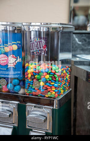Candy and bubble gum machines in a local beauty shop. - Stock Image