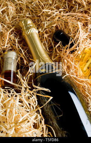 wine bottles in packed in excelsior - Stock Image