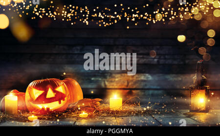 Spooky halloween pumpkins on wooden planks in dark cellar. Celebration theme, copyspace for text. Very high resolution image - Stock Image