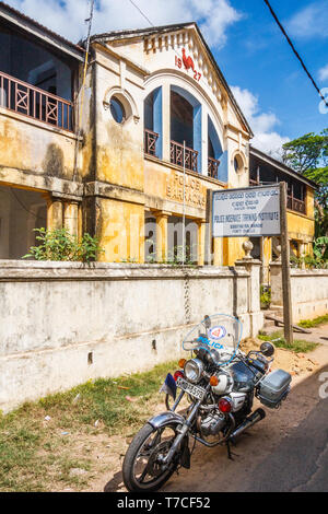 Galle, Sri Lanka - March 14th 2011: Motorbike parked outside the old Police Barracks. Th building dates from 1927. - Stock Image
