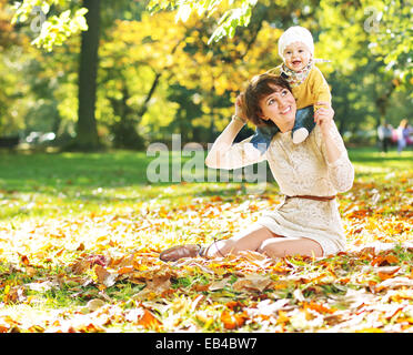 Charming mother playing with her cute baby - Stock Image