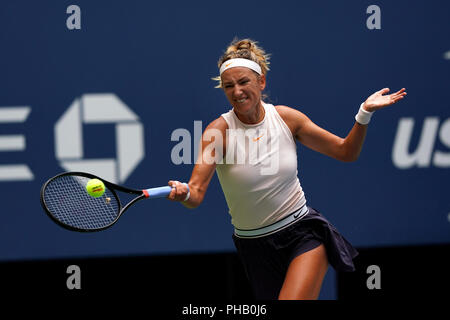 Flushing Meadows, New York - August 31, 2018: US Open Tennis:  Victoria Azarenka of Belarus returns a shot to number 3 seed, Sloane Stephens of the United States during their third round match against  at the US Open in Flushing Meadows, New York.  Stephens won the match in straight sets. Credit: Adam Stoltman/Alamy Live News - Stock Image