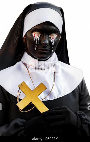 masks and clothes on helloween nun vampire on a white background - Stock Image