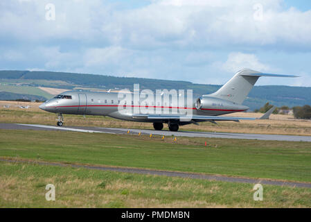 A Bombardier Challenger 850 lifting off from Inverness airport in the SCOTTISH Highlands UK. - Stock Image