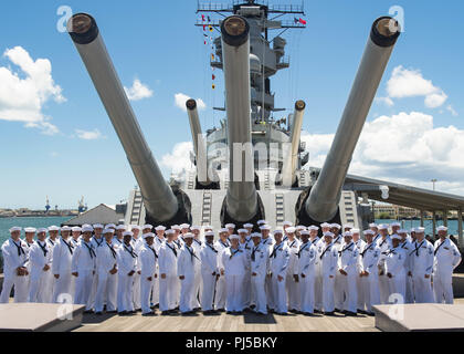 180831-N-ND356-0100 PEARL HARBOR (Aug. 31, 2018) The USS Missouri Chief Petty Officer (CPO) Legacy Academy Class 019 graduates pose for a graduation photo aboard the USS Battleship Missouri Memorial. The CPO Legacy Academy is a six-day course in which the chief petty officers and selectees live aboard the USS Battleship Missouri Memorial and participate in preservation activities, leadership training, reenact scenarios that took place aboard USS Missouri, and learn lessons about the history and heritage of the U.S. Navy and CPO community. The CPO Legacy Academy has taken place aboard the Battl - Stock Image