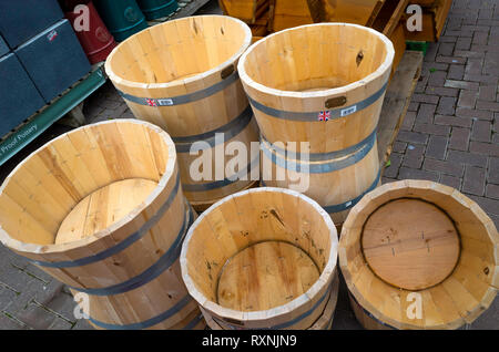 A garden centre display  of traditional wooden tubs with Made in Britian labels - Stock Image
