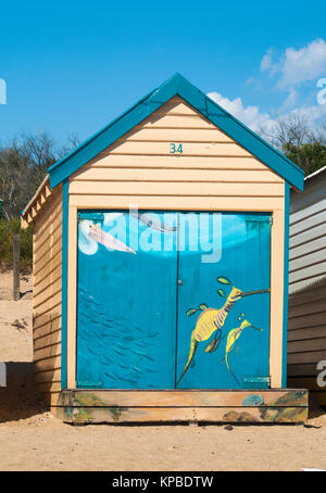 Bathing boxes on the Dendy Street Beach, at Brighton on Port Phillip Bay, Melbourne - Stock Image