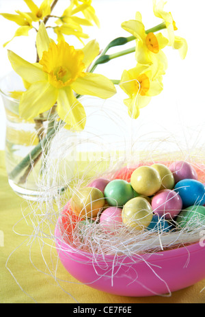 Easter egg filled with chocolate candy eggs. - Stock Image