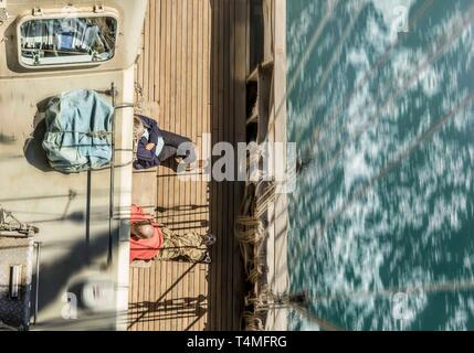 A birds eye view with motion from the mast of the Lord Nelson under sail in the UK. - Stock Image