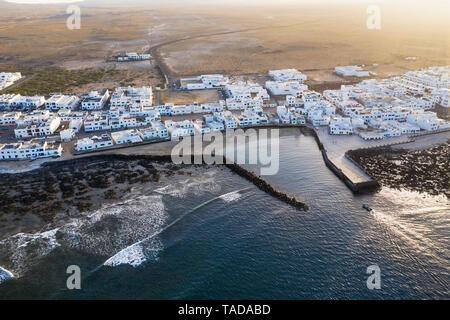 Spain, Canary Islands, Lanzarote, Caleta de Famara, aerial view - Stock Image