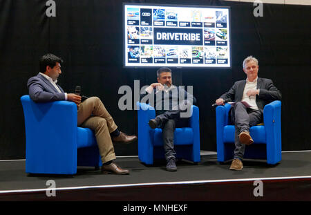 Formar F1 Driver, Karun Chandhok hosts an interview with  DriveTribe CEO Jonathan Morris and Chief Marketing Officer, Jim Murray Jones,   during the press day of the London Motor Show 2018. - Stock Image