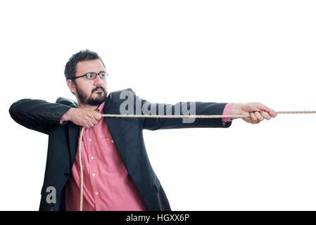 Man pulling a rope tug - Stock Image