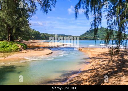 Creek running into the sea at Nai Yang beach, Phuket, Thailand - Stock Image