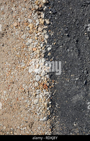 Texture of pebbles on a road. - Stock Image