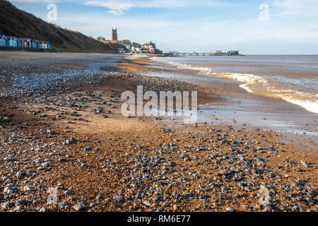 rows of beach huts on the seafront at cromer norfolk coast - Stock Image