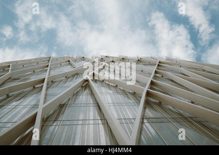 Front view from bottom of metal and glass facade of modern contemporary office skyscraper in Forum district of Barcelona - Stock Image